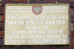 Image of the plaque on the front of the church notes it as the site of Wesley's Chapel built in 1759.